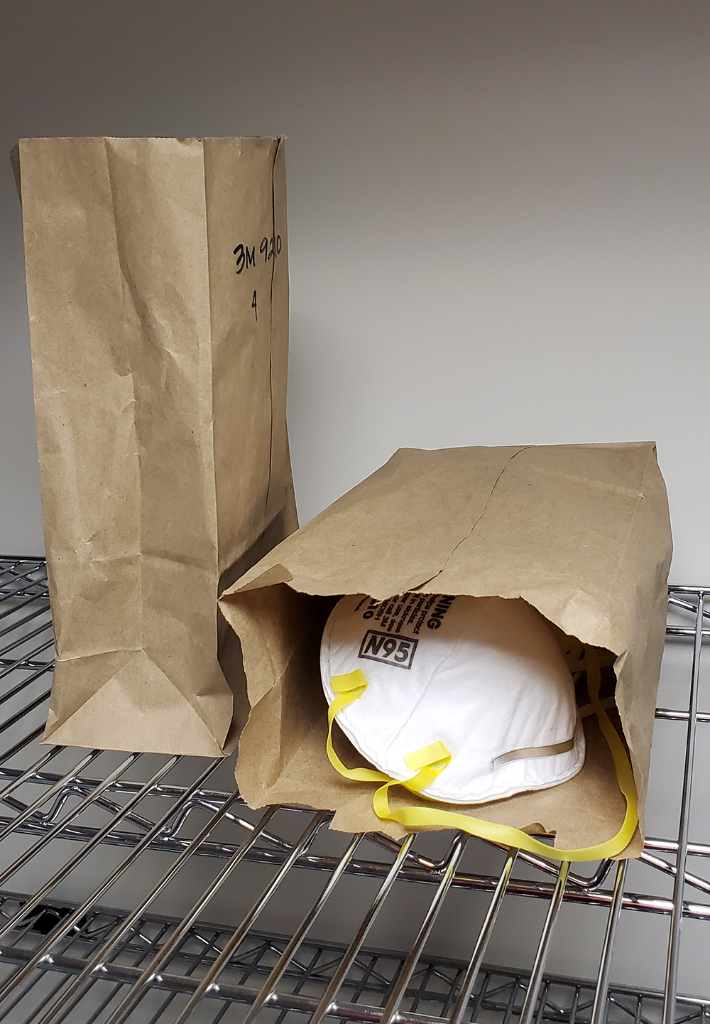 Decontaminated masks in individually labeled paper bags