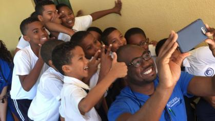 RSDM student takes a group selfie with Dominican school children