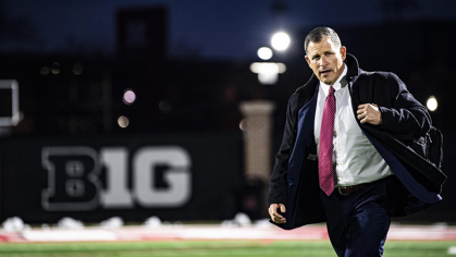 Greg Schiano in front of B1G sign