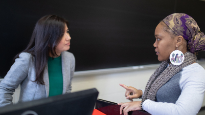 Assistant Professor Laura Cuesta-Rueda speaks with student Bianca Dossous during Social Welfare Policy and Services class in Conklin Hall 2019