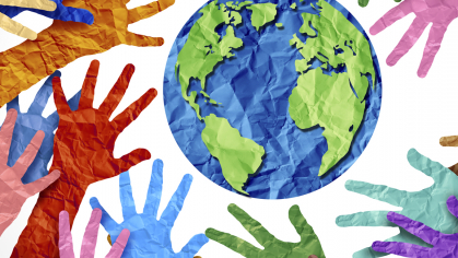 Multi color paper cut-out hands reaching towards the world globe