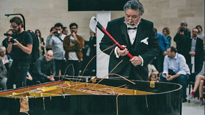 Raphael Montañez Ortiz at one of his many piano destruction concerts, at the Mudam museum in Luxembourg. Photo by Remi Villaggi.