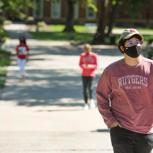 Javier Perez (SOE '22) wear his PPE face mask as he walks on Voorhees Mall during COVID-19 pandemic