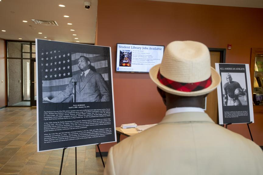 Rutgers Today, Rutgers News - Groundbreaking Honors Paul Robeson's Legacy as Civil Rights Activist, Rutgers Scholar - Alumnus Alfred A. Edmond Jr., Senior Vice President and Executive Editor-at-Large of Black Enterprise Magazine views posters of Paul Robeson's life at reception following the groundbreaking.