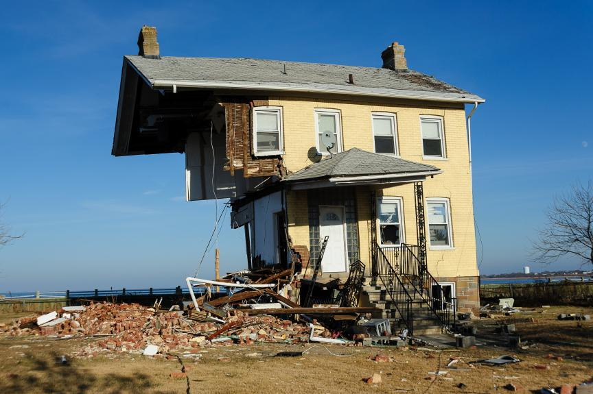 A tan-colored house that has been knocked in half due to Superstorm Sandy