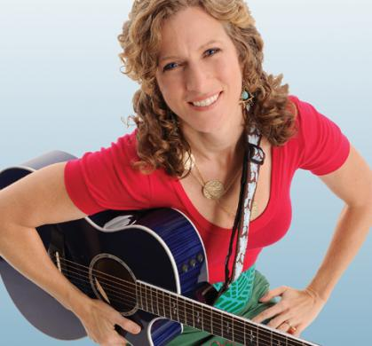Laurie Berkner with guitar