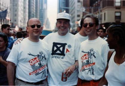 From left: Thomas Sokolowski, Patrick O'Connell, and Jimmy Morrow wear Visual AIDS' Day With(out) Art t-shirts featuring artwork by Barbara Kruger, 1994.